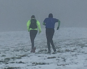 trail runners in snow